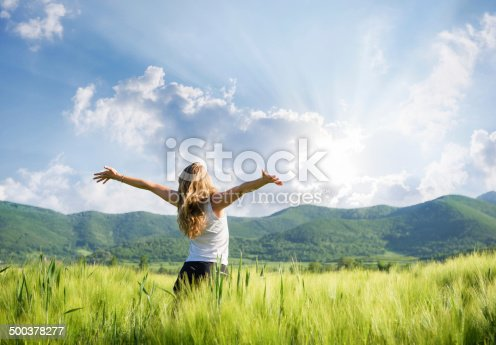 istock One young woman Feeling free outdoor in the wheat field 500378277
