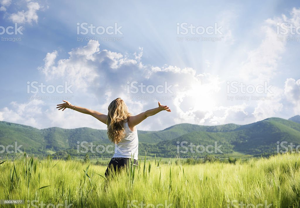 One young woman Feeling free outdoor in the wheat field stock photo