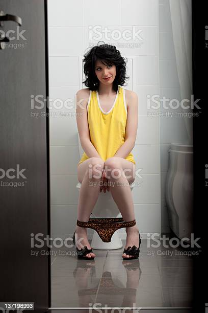 Young Woman Sitting On Toilet Stock Photo 225935446