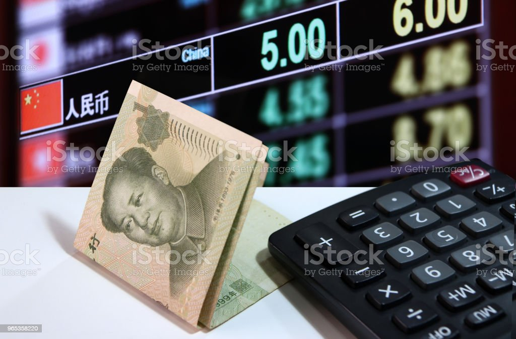 One yuan banknote of China and calculator on the white floor with digital board of currency exchange money background. zbiór zdjęć royalty-free