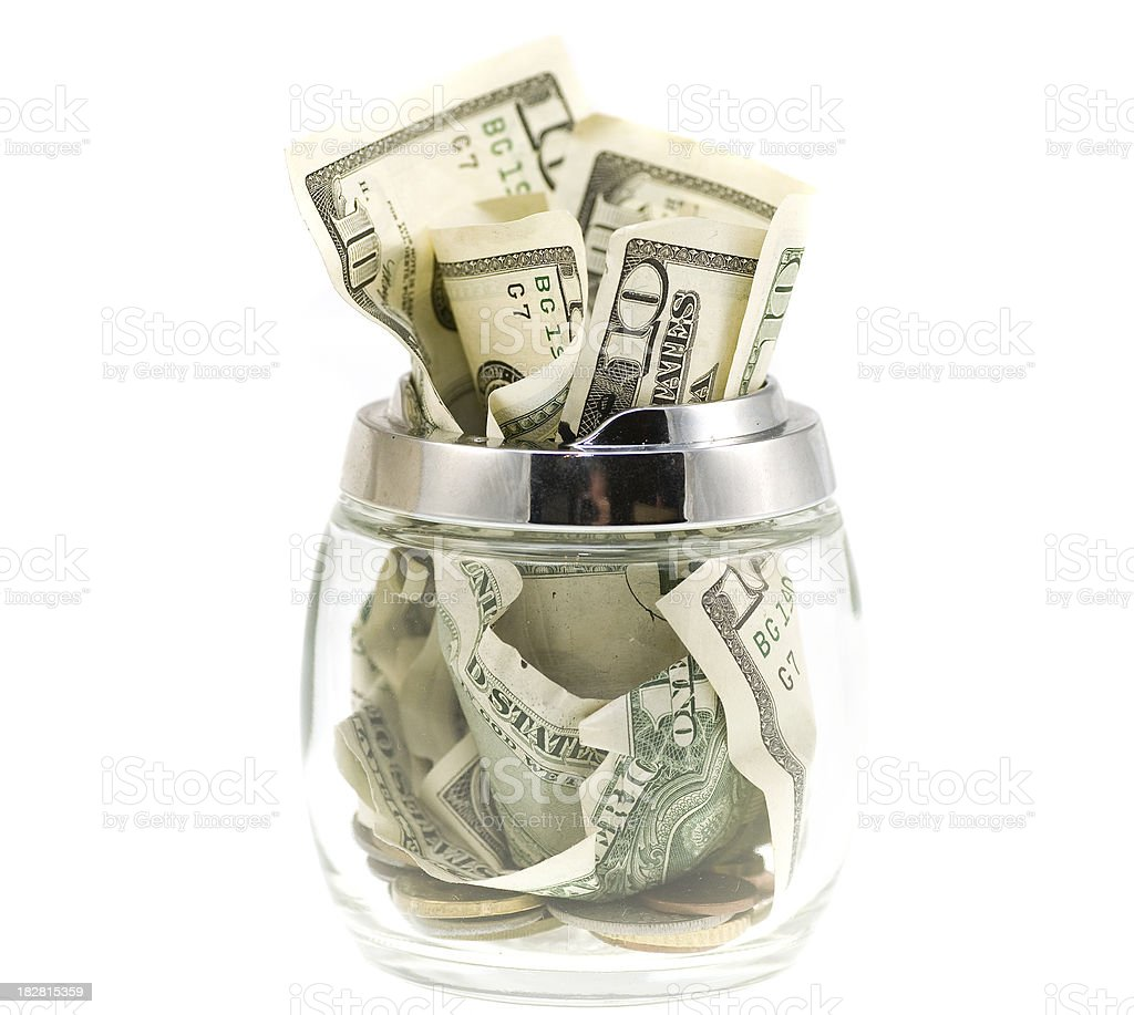 One-dollar and ten-dollar notes inside glass jar royalty-free stock photo