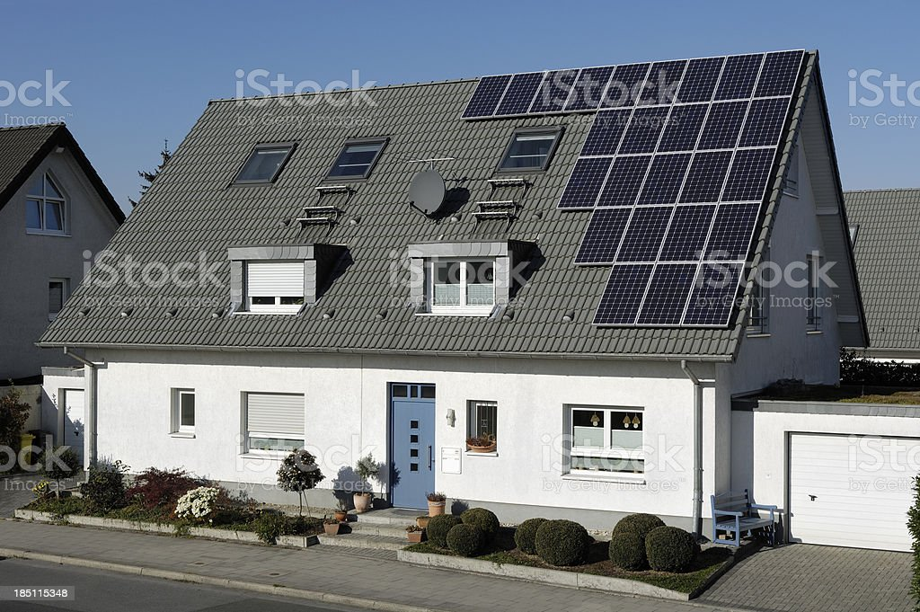 One-family houses with solar panels on the roof royalty-free stock photo