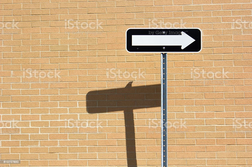 One-way traffic sign on Brick Wall stock photo