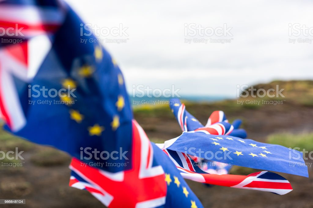 Ongoing Brexit flags - UK and EU stock photo