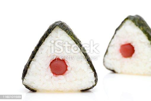istock Onigiri. Rice triangle with nori and umeboshi 1160101559