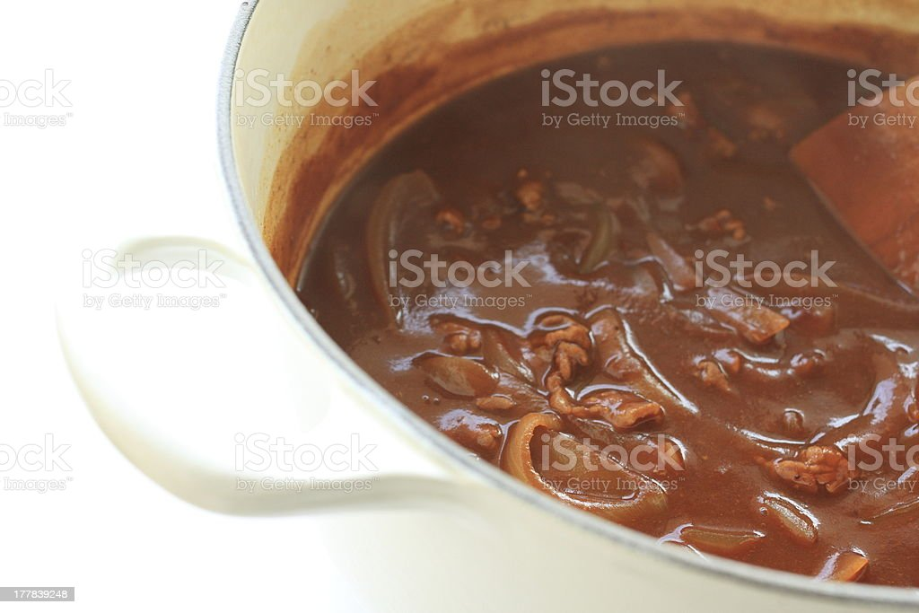 onion and beef stew in pan stock photo