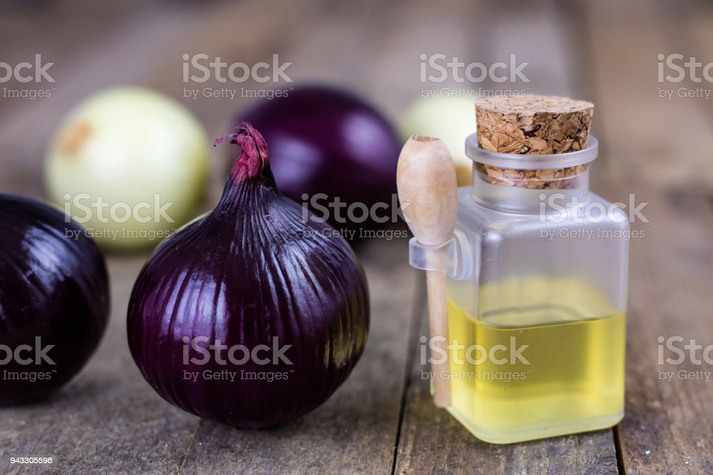 Onion and medicinal juice for a cold. Natural and alternative methods of treatment. Light background. stock photo