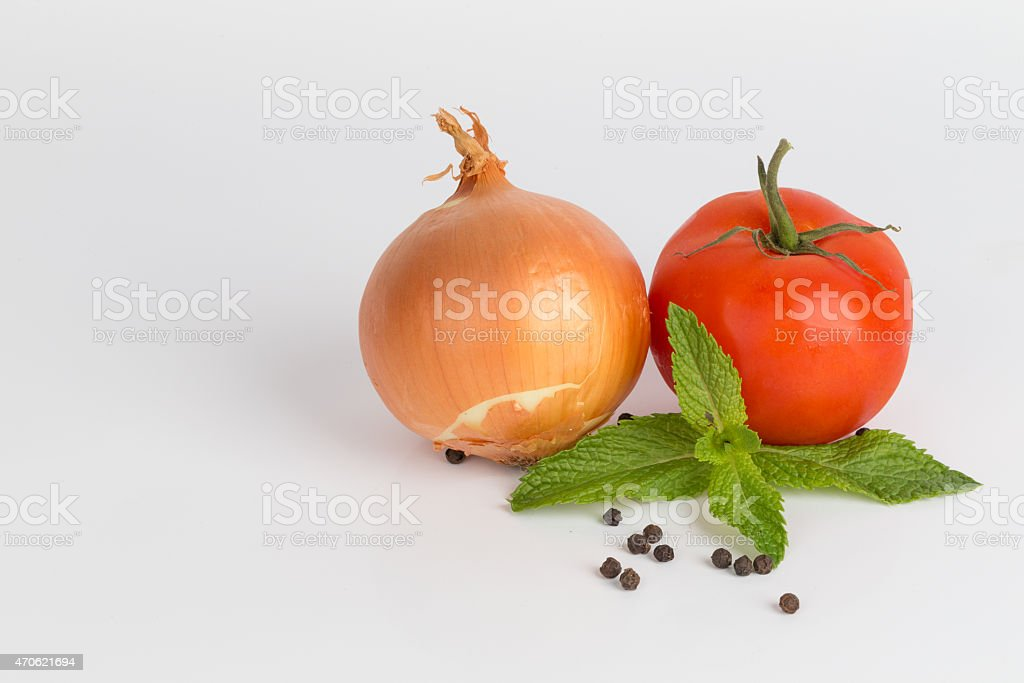 Onion and Tomatoes with fresh Mint leaves and peppercorns stock photo