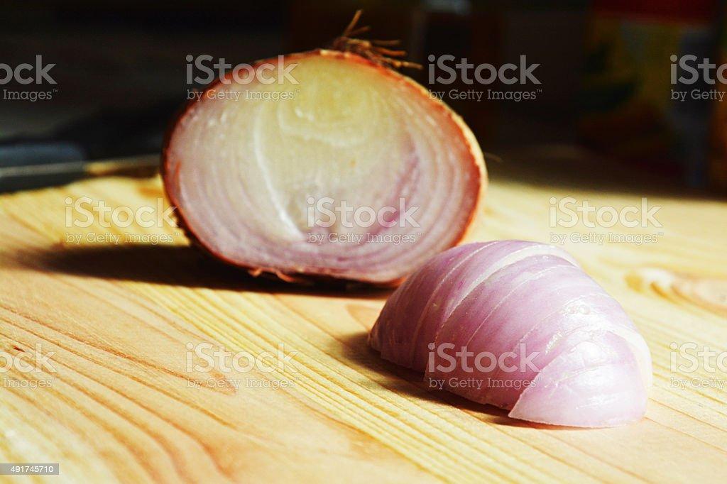 onion at cutting board stock photo