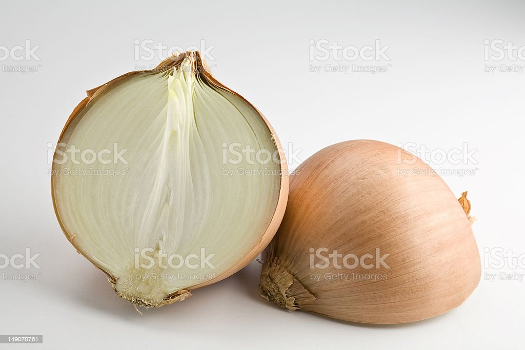 Onion Large onion sliced in half isolated Chopped Food Stock Photo