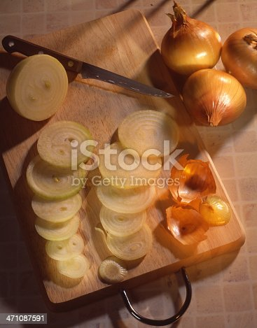 Onion rings on a cutting board.