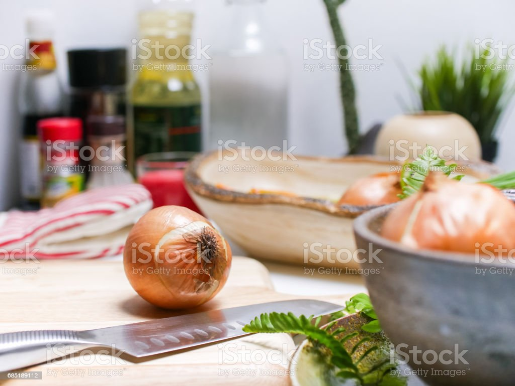 Onion prepared for sliced in kitchen royalty-free stock photo