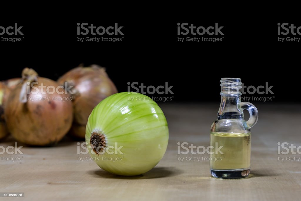 Onion the best specific  for influenza. Syrup prepared from onions. Black background. stock photo