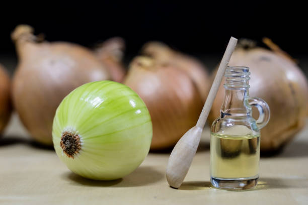 onion the best specific  for influenza. syrup prepared from onions. black background. - onion juice stock photos and pictures