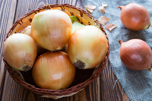 onions in a basket on a napkin closeup