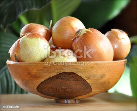 Wooden bowl of onions