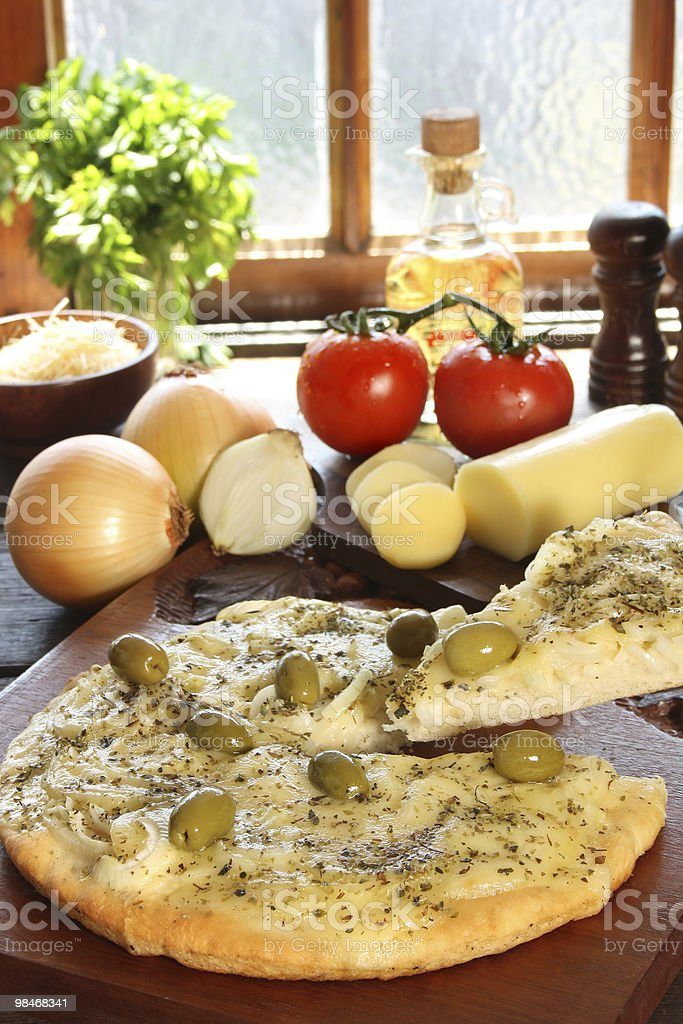 Onions pizza with olives and ingredientes royalty-free stock photo