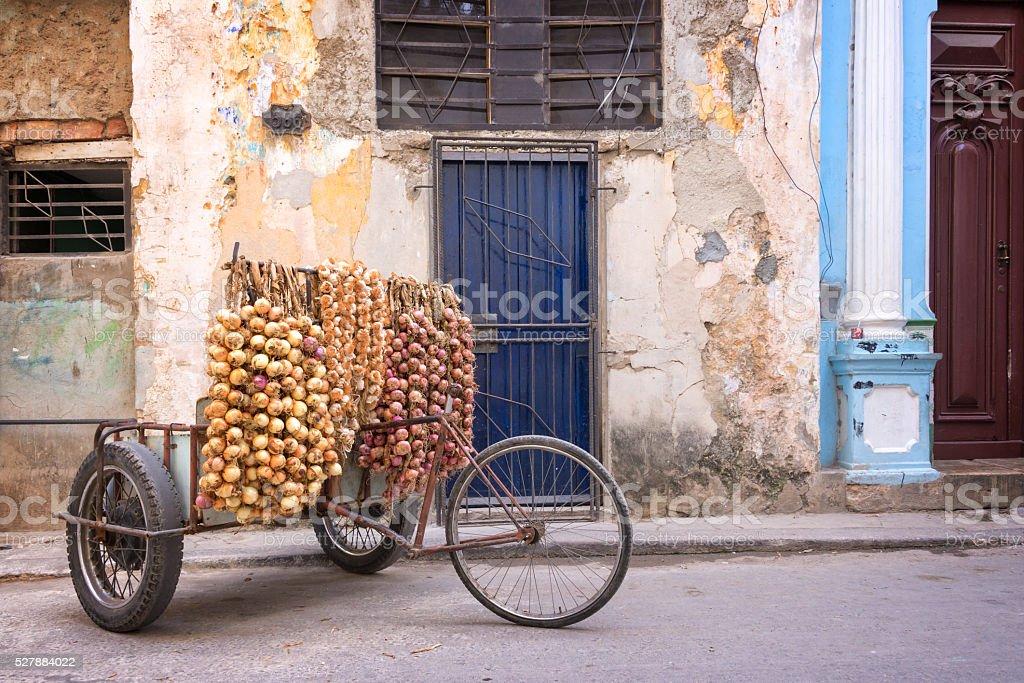 Onions seller in a street of Old Havana, Cuba stock photo