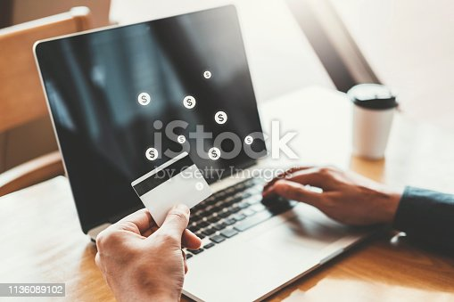 istock Online banking businessman using Laptop with credit card Shopping online Fintech and Blockchain concept 1136089102