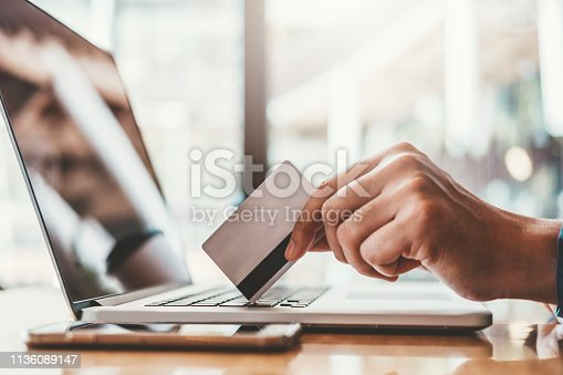 istock Online banking businessman using Laptop with credit card Shopping online Fintech and Blockchain concept 1136089147