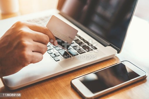 istock Online banking businessman using Laptop with credit card Shopping online Fintech and Blockchain concept 1136089158