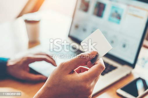 istock Online banking businessman using Laptop with credit card Shopping online Fintech and Blockchain concept 1136089169