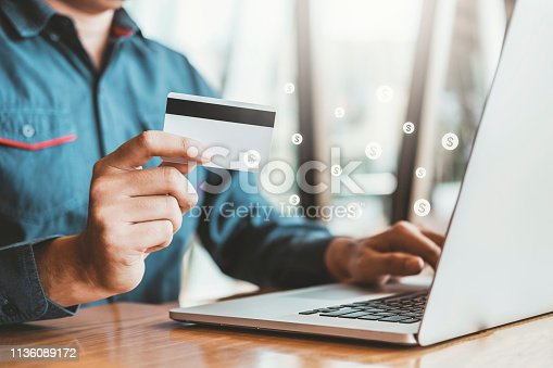 istock Online banking businessman using Laptop with credit card Shopping online Fintech and Blockchain concept 1136089172
