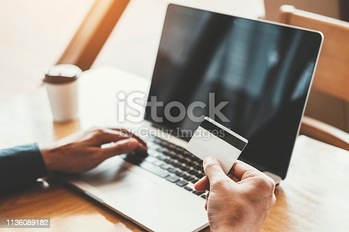 istock Online banking businessman using Laptop with credit card Shopping online Fintech and Blockchain concept 1136089182