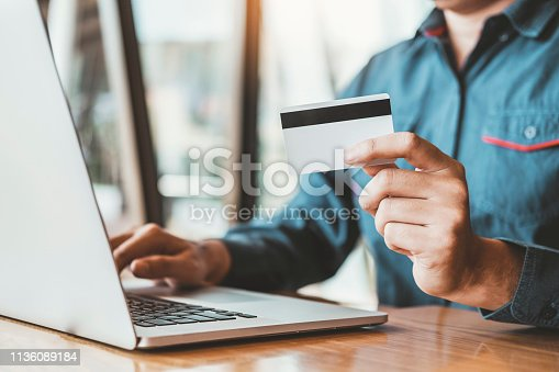 istock Online banking businessman using Laptop with credit card Shopping online Fintech and Blockchain concept 1136089184