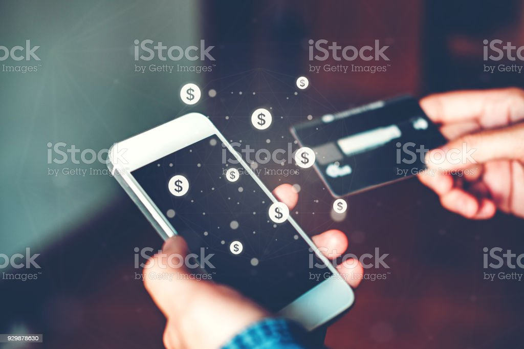 Online banking businessman using smartphone with credit card Fintech and Blockchain concept stock photo