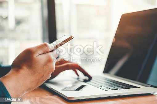istock Online banking businessman using smartphone with credit card Shopping online Fintech and Blockchain concept 1136089191