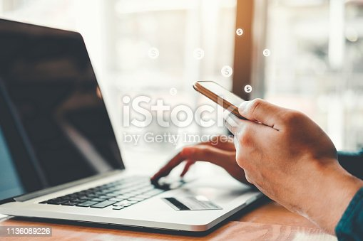 istock Online banking businessman using smartphone with credit card Shopping online Fintech and Blockchain concept 1136089226
