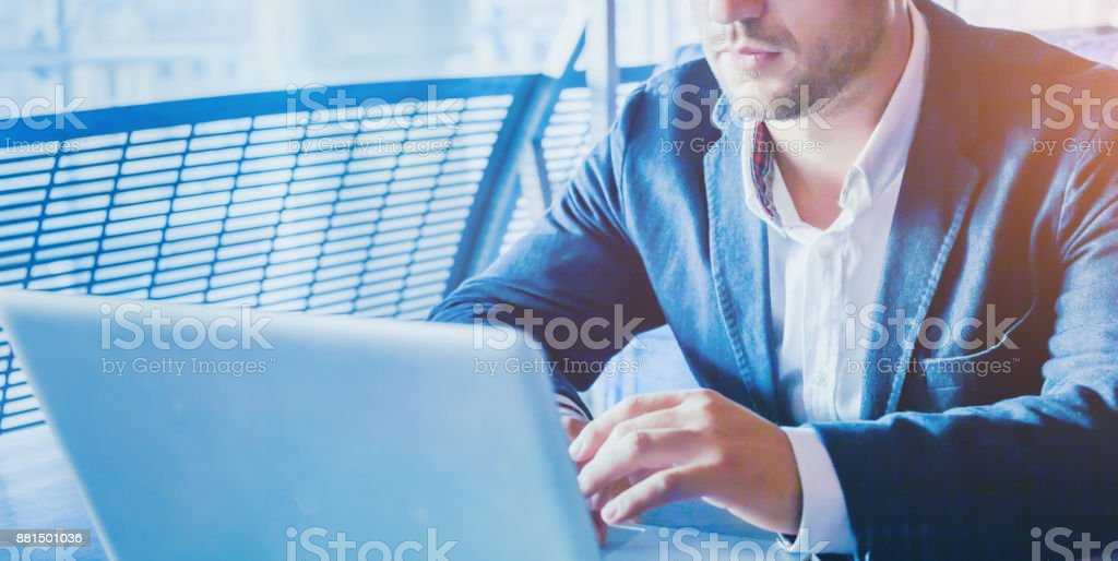 online banking, man working on laptop stock photo