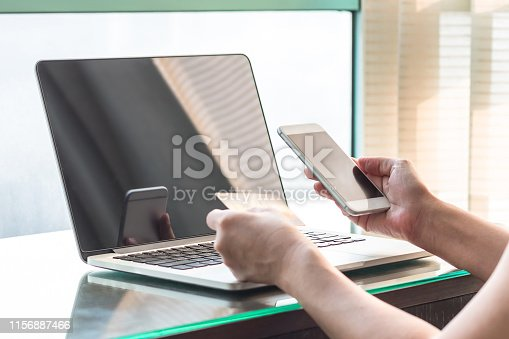 846708102 istock photo Online banking payment with consumer using credit card paying purchase for online shopping business via internet communication on smart phone and laptop 1156887466