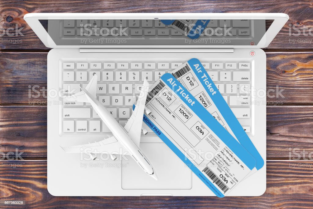 Online Booking Concept. Airline Boarding Pass Tickets with Jet Airplane over Laptop over Wooden Table. 3d Rendering stock photo