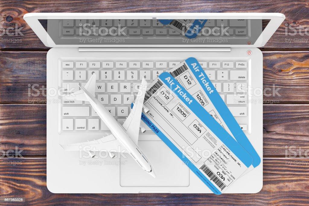 Concept de réservation en ligne. D'embarquement Airline Tickets avec Jet avion sur ordinateur portable sur la Table en bois. rendu 3D - Photo