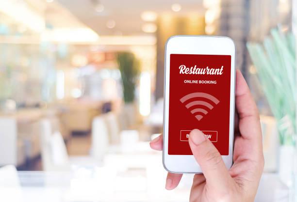 Online booking over blur restaurant background, food and drink, restaurant reservation stock photo