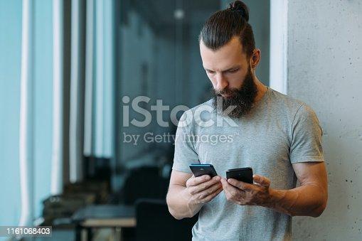 istock online business communication man smartphones 1161068403