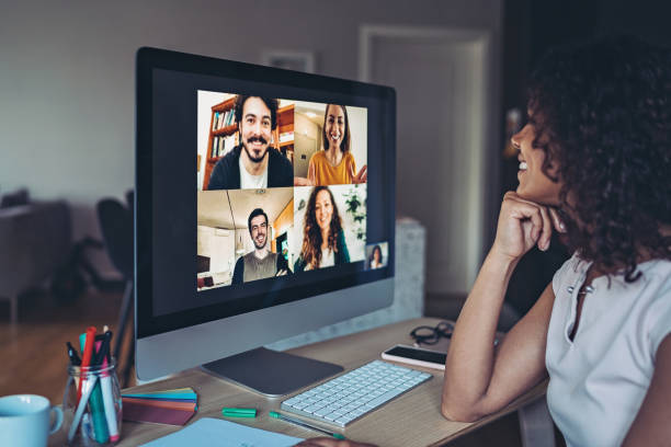 Online business meeting Group of people having a video conference collaboration stock pictures, royalty-free photos & images
