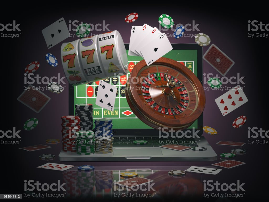 Online casino concept. Laptop roulette, slot machine, chips and  cards stock photo