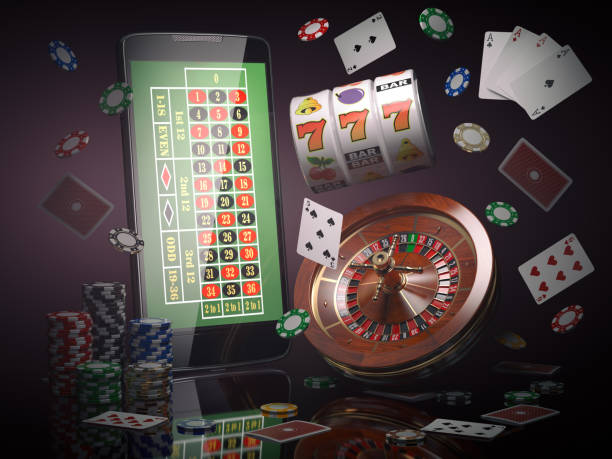 Online casino concept. Mobile phone, roulette with casino chips, slot machine and cards. stock photo