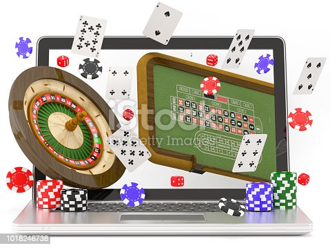 Online Casino- Laptop with roulette, casino chips and playing cards