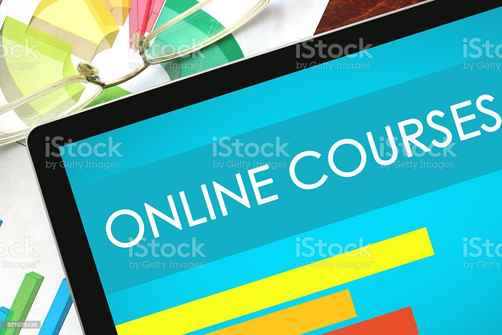 Online Courses written on a tablet. stock photo