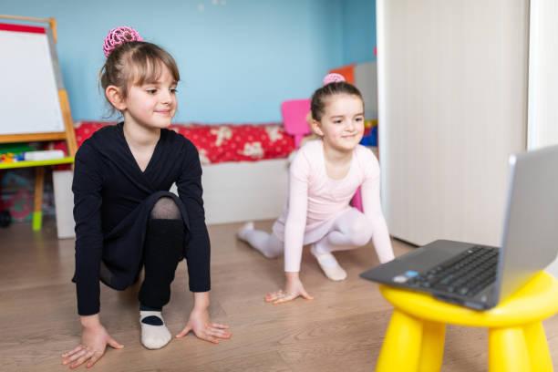 Online dance class, homeschooling during pandemic coronavirus quarantine lockdown stock photo