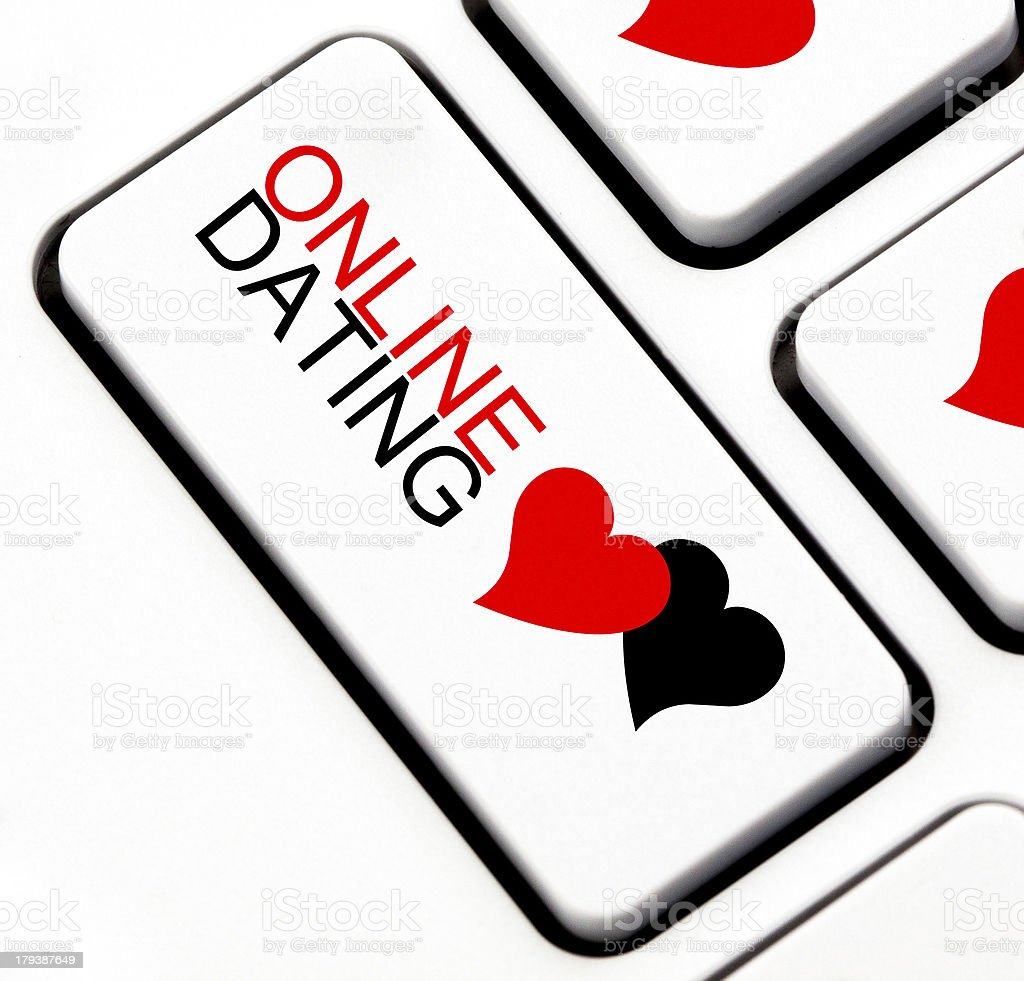 Online dating button with heart shaped talk cloud stock photo