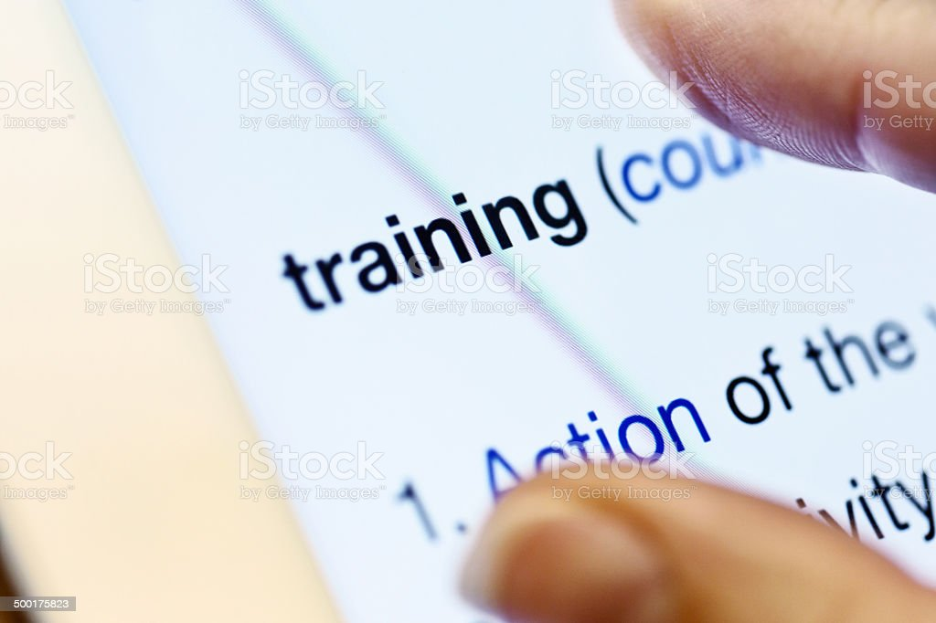 Online Dictionary Definition Of Training Displayed On Digital Tablet