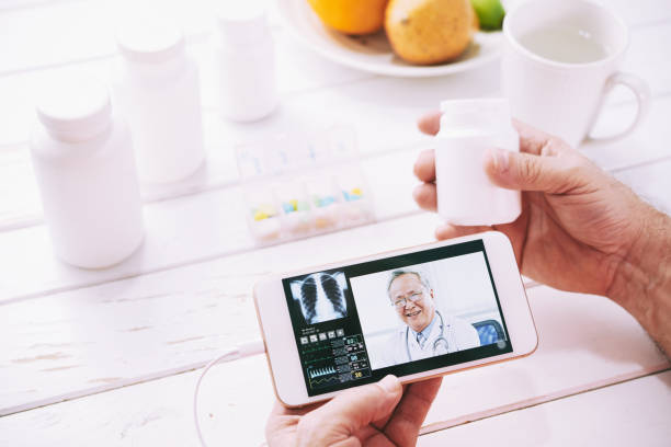 online doctor consultation - doctor visit stock photos and pictures