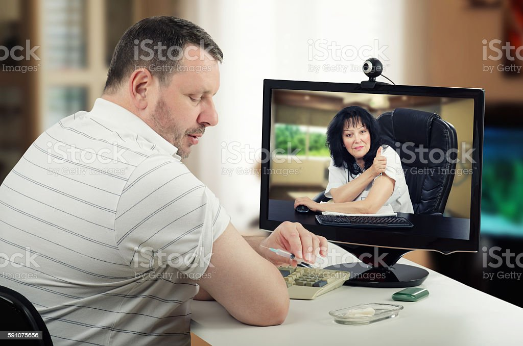 Online doctor correcting intramuscular injection stock photo