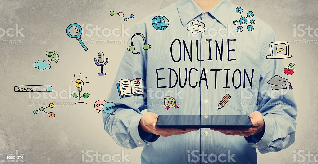 Online Education concept with young man holding a tablet stock photo