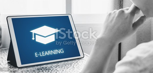 istock Online education, e-learning and e-book concept. a man using digital tablet for education at home 1037246348